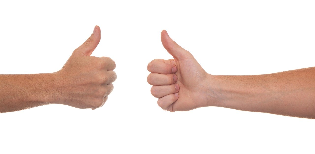 image of two people giving a thumbs up
