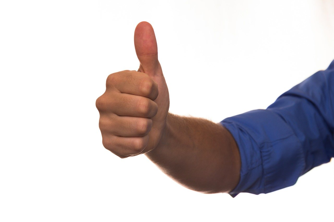 image of a man giving a thumbs up